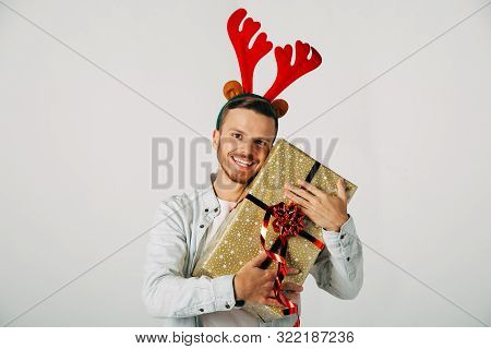 The Guy Is Surprised, Looking At The Camera. Masquerade Man Red Horns At A Christmas Party. Somethin