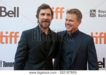 TORONTO - SEPT 9: Christian Bale (L) and Matt Damon attend the