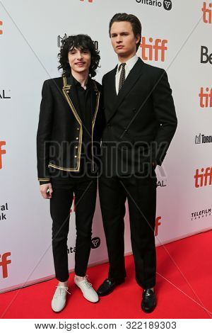 Finn Wolfhard (L) and Ansel Elgort attend