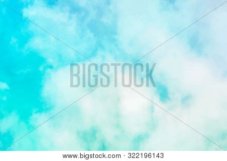 Vector Abstract Background Of A Vibrant Teal Blue Sky With Soft Puffy Clouds