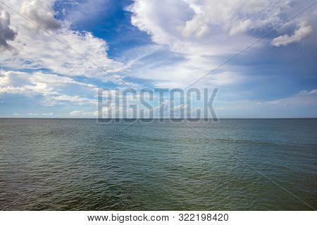 Cloudy Sky And Smooth Atlantic Ocean Meet.