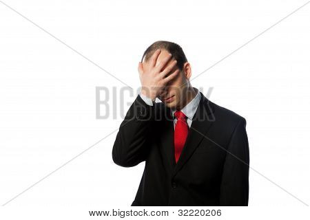 Despaired Businessman With Face In His Palm