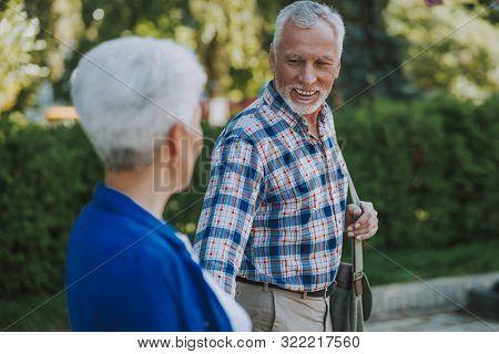 Mirthful Mature Man Smiling To Woman Stock Photo