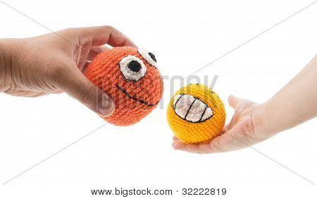 Two Toys In Woman And Man Hands