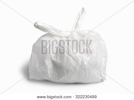 White Plastic Bag On White Background. A White Plastic Bag Texture, Macro, Background. Reduction Of