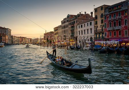 Venice, Italy - May 19, 2017: Gondola With People Sails On Grand Canal In Venice At Night. Gondola I