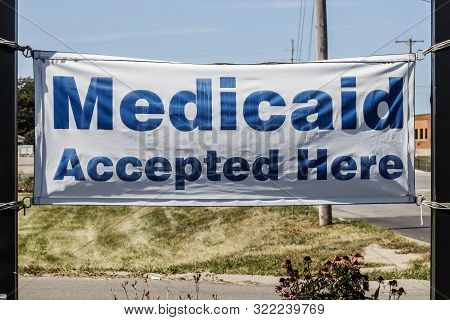 Kokomo - Circa September 2019: Medicaid Accepted Here Sign. Medicaid Is A Federal And State Program