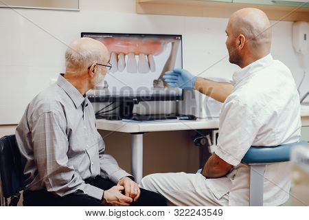 Old Man Sitting In The Dentists Office