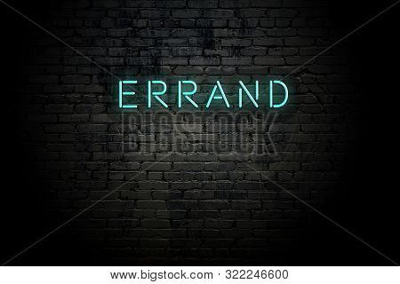 Highlighted Brick Wall With Neon Inscription Errand.