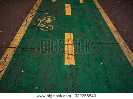 Bicycle Sign On Asphalt. Bicycle Line In King Mihai I Park (herastrau Park) In Bucharest, Romania, 2