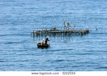 Small Bamboo Boat On The Sea