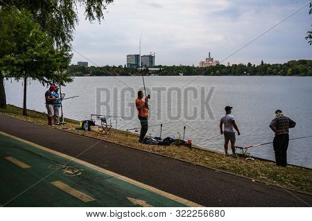 People Fishing In King Mihai I Park (herastrau Park) In Bucharest, Romania, 2019.