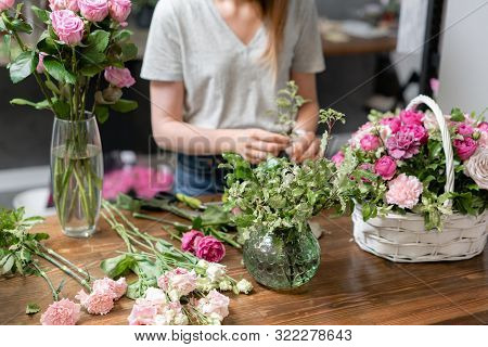 Handsome Fresh Bouquet. Flowers Delivery. Woman Florist Create Flower Arrangement In A Wicker Basket