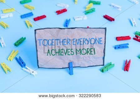 Handwriting text writing Together Everyone Achieves More. Concept meaning Members create synergy with strong sense mutual commitment Colored clothespin papers empty reminder blue floor background office pin. poster