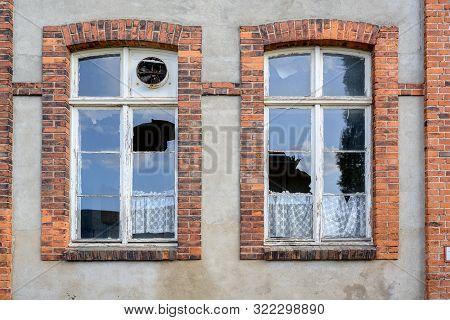Broken Window Panes In An Older House, Vandalism Concept