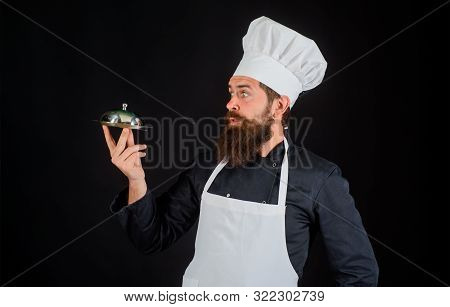 Waiter. Chef Presenting Silver Tray. Chef Man In Uniform With Cloche Food. Servant Carry Metallic Cl