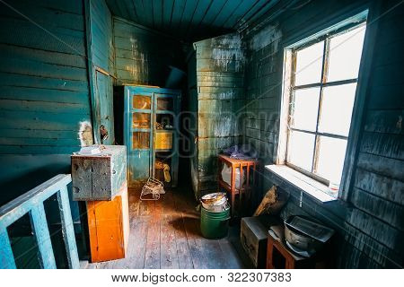 Dark And Shabby Messy Room In Poor Apartment Of Old Emergency Abandoned Wooden House, Poverty Concep