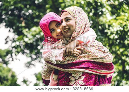 Portrait Of Happy Lovely Family Arabic Muslim Mother And Little Muslim Girls Child With Hijab Dress