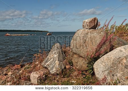 A Pile Of Large Rocks By The Sea At The Fishing Harbour Of Kalajoki, Finland. The Wind Is Blowing Ha