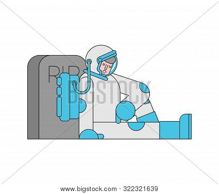 Sad Astronaut Is Sitting By Grave. Spaceman And Headstone