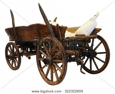 Wooden cart wagon carriage with sacks load isolated on white background