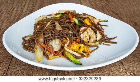 Bowl Of Stir Fried Udon Noodles With Mixed Seafood And Eggs. Asian Traditional Food: Yaki Soba Tori