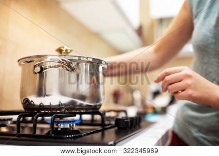 Beautiful Young Woman Housewife Prepairing Dinner, Hold In Hands Big Steel Saucepan, Standing It On