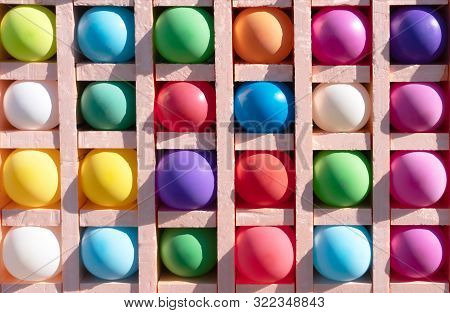 Inflatable Multi-colored Balls In Cells For Playing Darts. Colorful Background, Rainbow Colors.