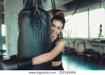 Female Sporty Boxer Is Exercised Training Punching In Fitness Club, Portrait Of Boxer Woman With Box