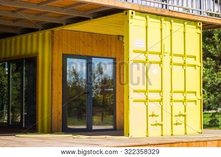 Almaty, Kazakhstan - July 08, 2019: Modern Metal Building House Made From Shipping Yellow Containers