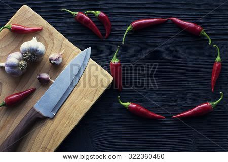 Knife Garlic Wooden Board Chili On A Dark Background