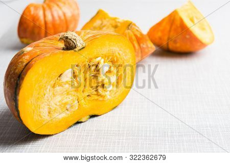 Half Of Fall Pumpkin. Autumn Traditional Vegetable. Natural Healthy Organic Food. Orange Ingredient