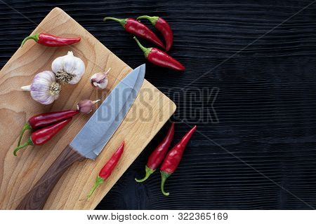 Chef  Knife Garlic Wooden Board Chili On A Dark Background