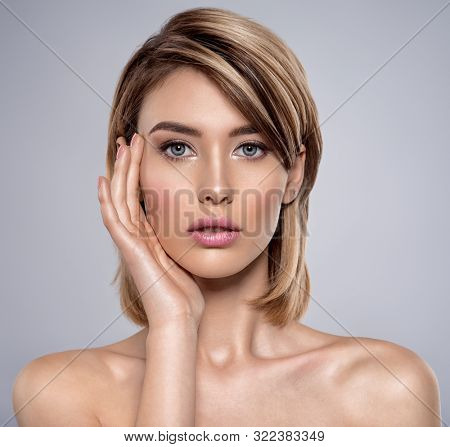 Front portrait of the woman with beauty face - isolated on white. Portrait of beautiful young blond woman with clean face. Attractive model. Beautiful face of young woman with clean skin.