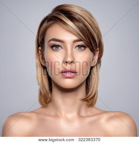 Front portrait of the woman with beauty face - isolated. Portrait of beautiful young blond woman with clean face. Attractive model. Beautiful face of young woman with clean skin.