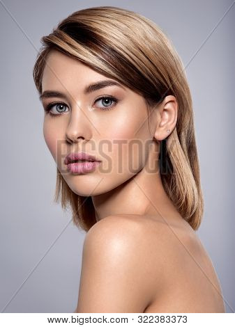 Close-up portrait of sexy caucasian young woman with beautiful blue eyes. Portrait of beautiful young blond woman with clean face. Attractive model. Beautiful face of young woman with clean skin.
