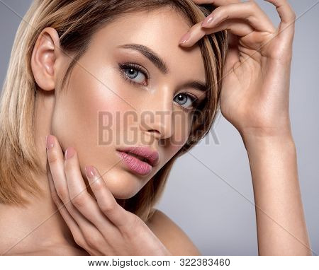 Portrait of the woman with beauty face - isolated on white. Portrait of beautiful young blond woman with clean face. Attractive model. Beautiful face of young woman with clean skin.