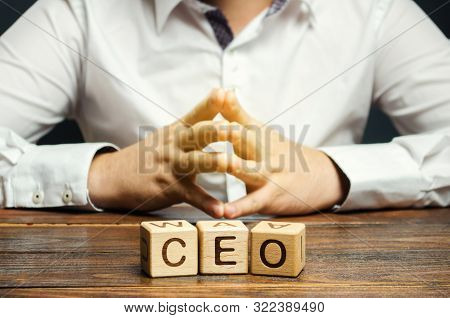 Wooden Blocks With The Word Ceo And Businessman. Chief Executive Officer. Boss, Top Management Posit