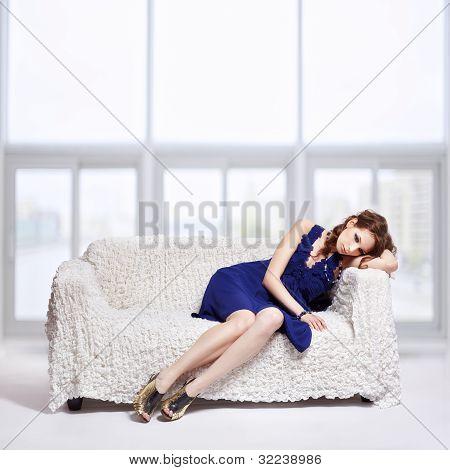 Brunette Relaxing On Sofa