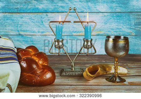 Sabbath Jewish Holiday Homemade Sesame Challah Bread And Candelas On Table
