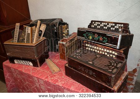 Veliky Novgorod, Russia - August 16, 2019. Old Musical Instruments - The Exhibits Of An Ethnographic