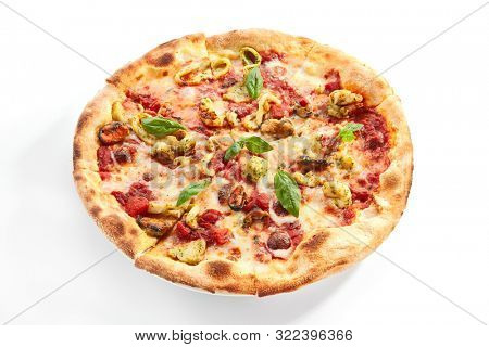 Seafood pizza closeup. Sliced traditional Italian cuisine with squid and mussel meat. Pizzeria restaurant dish isolated on white background. Sea food ingredients on baked dough concept