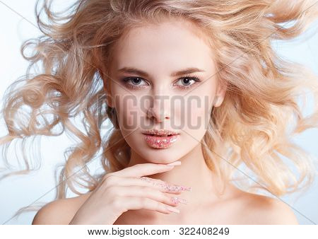 Close-up Portrait Of Beautiful Curly Blondy Woman With Perfect Art Make-up, Trendy Frosted Nail Desi