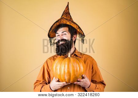 Halloween Beaded Man Hold Pumpkin - Portrait. Happy Halloween - Handsome Man Isolated. Smiling Happy