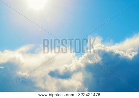 Blue dramatic sky background - picturesque colorful clouds lit by sunlight. Vast sky landscape panoramic scene, colorful sky background. Blue sky landscape, vast sky scene with sky clouds. Blue sky background