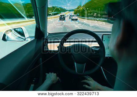 Person In A Self Driving Autonomous Car With Autopilot