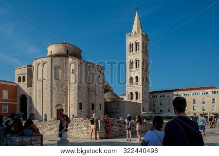 Zadar, Croatia - August 17, 2017: Tourists In Front Of Church Of St Donatus, Roman Forum And Cathedr