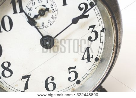 Old Analog Clock With Hands And Numbers. Analog Metal Alarm Clock. Vintage And Antique Object