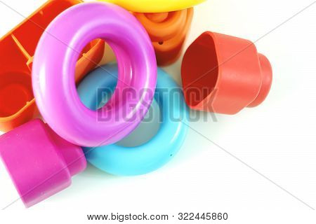 Colored Plastic Rings And Rubber Bricks For Children To Play.