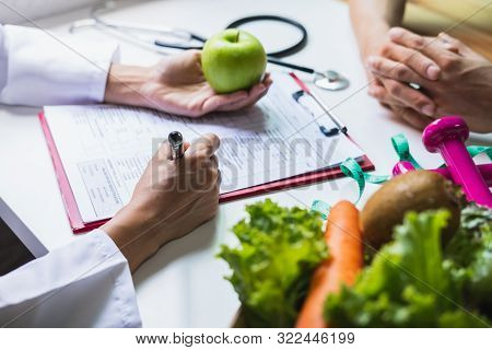 Nutritionist Giving Consultation To Patient With Healthy Fruit And Vegetable, Right Nutrition And Di